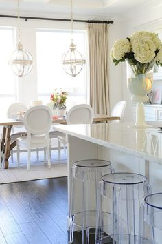 white kitchen space - the clear bar stools are fun!