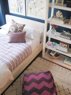 All of that white keeps things light and fresh, a great balance to the purple and deep blue walls.  Love the mix of prints.
