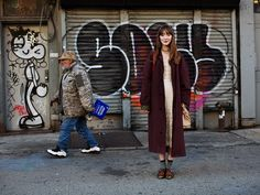 On the Street...The Bowery, NY  Long maroon coat / lace dress / gothic necklace / scuffed leather shoes