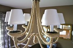 Knockoff DIY Chandelier - Remodelaholic | Remodelaholic  I kind of like this, but with different shades.