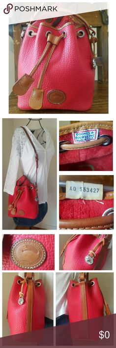 Vintage Dooney & Bourke AWL Drawstring Limited Edition D&B All-Weather Leather Drawstring in excellent vintage condition; Red w/British Tan trim & Nickle accents. Minor darkening of the leather on the front right bottom (see pic 5). Very immaculate inside & out. Nickle Dooney duck fob. Snipped tag: Serial #A0553427.❤From my 🚬🆓🐶🐱🆓🏠. 〰N🚫 TRADES, N🚫 HOLDS, N🚫 LOWBALL OFFERS〰 🌷This listing is for the D&B Drawstring bag ONLY🌷 Dooney & Bourke Bags Shoulder Bags