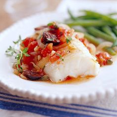 These fork-tender fish fillets reflect the cooking style of the Provence region of France. Dishes from the area quite often include olive oil, onion, garlic, tomatoes, and olives.