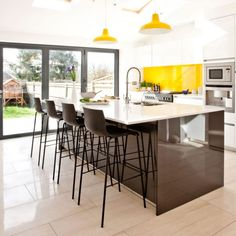 Modern Kitchen With sleek and glossy Island Dwellingdecor