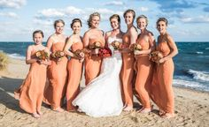 We love the orange dresses sported by this darling bridal party! // Paul Blackmore Photography
