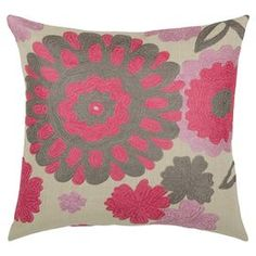 "Brimming with floral flair, this chic cotton pillow showcases a colorful array of blossoming medallions. Product: PillowConstruction Material: Cotton cover and siliconized polyester fiber fillColor: Natural and pinkFeatures:  Insert includedZippered closure Dimensions: 18"" x 18""Cleaning and Care: Hand wash in cold water with mild detergent"
