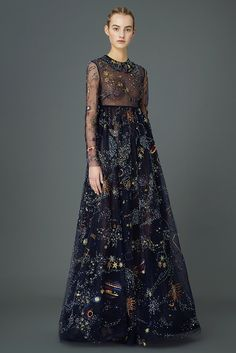 """Designers Maria Grazia Chiuri and Pierpaolo Piccioli pulled out all the stops for Valentino's Pre-Fall 2015 collection by including dresses, skirts, and a cape that were all space-inspired. Moons, planets and constellations adorned the clothes and accessories, which made the Internet swoon. As fashion blog Fashionista states, """" It looked gorgeous, with just the right amount of kitsch. The collection as a whole felt relevant, wearable and still very Valentino. Chiuri and Piccioli always know…"""