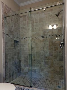 can you get coated glass for easier cleaning? Is this more up to date vs. framed doors or block tiles? Frameless Shower Doors