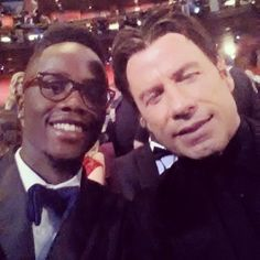 """Pin for Later: Remember When Lupita's Brother Had the Best Award Season Ever? And an Oscars Selfie With His """"Buddy"""" John Travolta Source: Instagram user nyongolaflame"""