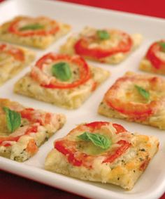 tomato basil squares 1 package (10 ounces) refrigerated pizza dough 2 cups shredded mozzarella cheese, divided 1/4 cup Parmesan cheese, grated 2 teaspoons dried basil leaves 3/4 cup mayonnaise 1 garlic clove, pressed 4 to 5 plum tomatoes, seeded, thinly sliced