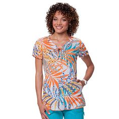 This scrub top from Koi Happiness Scrubs features a print with lots of on-trend orange.  #scrubs