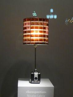 Old camera lamp, with negatives as lamp shade.