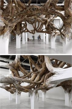Brazilian artist, Henrique Oliveira, creates a voluminous installation of wood in Palais de Tokyo, Paris.The vast structure which appears to grow out from the supportive columns of the room conquers the space. Constructed from a mass of twisting and turning tapumes – wood used to fence construction sites in Brazil – the installation evokes the characteristics of a living organism.