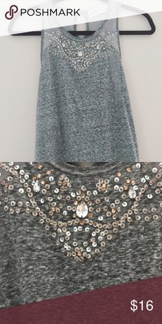 XS Abercrombie Tank Top Gorgeous XS gray Abercrombie & Fitch tank top with a beaded detail on the chest. This top sits above your collar bone. Perfect for the upcoming holiday season. So cute, I just never grab for it! New without tag Abercrombie & Fitch Tops Tank Tops
