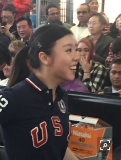 Bill with U.S. Olympic team member, Ariel Hsing, at ping pong match at Berkshire Hathaway event at Borsheim's in Omaha, Nebraska.