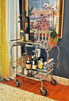 Mid Century Bar Cart and wine opener - elegantly mobile bar in your house. LIKE!