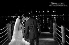 This sweet couple took a moment for themselves along the Seven Seas Lagoon #Disney #wedding