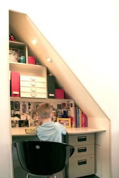 Tucked under a stairway, this desk uses space that would typically be unused and wasted