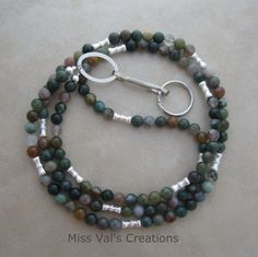 Fancy jasper. A stone with rich earthy tones. Available in ID badge lanyards and eyeglass chains.