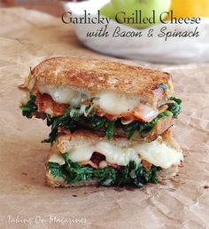 [American] Garlicky Grilled Cheese with Bacon and Spinach | Taking On Magazines | www.takingonmagazines.com | It's hard to believe this garlic-infused grilled cheese sandwich is healthy. Yes, there's spinach, but there's also glorious bacon.