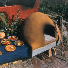 Build your own wood-fired earth oven with this easy-to-make oven and bake crusty breads, tasty pizzas and roasted meats. Includes diagrams, creating the oven floor and mixing mud.data-pin-do=
