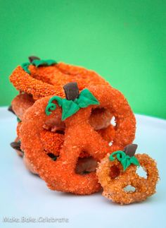 Chocolate Covered Pumpkin Pretzels - I would just dye the white chocolate orange and skip the sprinks. :-)