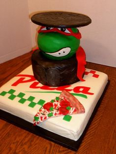 Teenage Mutant Ninja Turtles Cake - I'm thinking that I like the pizza box/slice...but instead of the head, finding 4 little action figures to stand on top of a man-hole...on top of the pizza box...