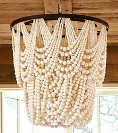 Pottery Barn Amelia Wood Bead Indoor/Outdoor Chandelier chandelier These 8 Beaded Chandeliers Are Statement Gems for the Home Wood Bead Chandelier, Chandelier Lamp Shades, Outdoor Chandelier, Chandelier Lighting, Chandeliers, Decorative Chandelier, Lustre Exterior, Indoor Outdoor, Idee Diy
