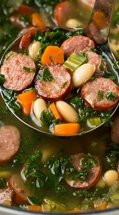 Kale White Bean and Sausage Soup _ This soup is destined to be a definite crowd pleaser. My whole family absolutely loved it! And bonus, I love how easy it was to make!