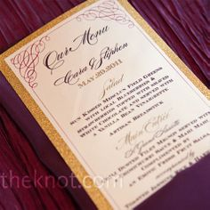Gold-backed Menu Cards    The gold-backed menu cards matched the escort card design and were tucked into plum-colored linen napkins.