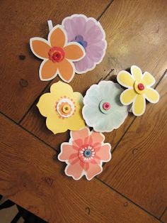 So I found these flowers at Dollar Tree. They come with a little vase. I had this notion, that this could be used two different ways and i...