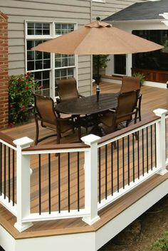 Entertain your guests in style with this Fiberon Horizon composite deck and railing. (decking shown in Ipe, railing in white with black balusters)