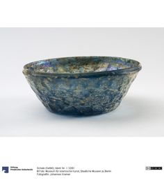 Cup (vessel)       901 - 1200      Dating Engl .: 10th - 12th century      Origin (General): Iran (Country)       transparent light blue glass blow-molded,      Height: 5 cm      Diameter: 12.8 cm      Wall thickness: approx 0.2cm       Ident.Nr. I. 32/61      Collection: Museum of Islamic Art       © Photo: Museum of Islamic Art of the National Museums in Berlin - Prussian Cultural Heritage      Photographer / in: John Kramer