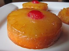 Pineapple Upside Down Cupcakes - warning: use a jumbo muffin pan or else you'll make many more cupcakes than she suggests and need more pineapple/cherries!