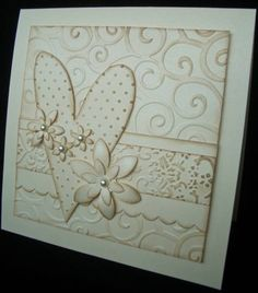 handmade Valentine card ... swirls embossing folder texture background ... belly band and big heart with different embossing folder textures ... creamy white lightly sponged with kraft color ink to make the textures show ... pretty look with a few punched flowers to top it off ...