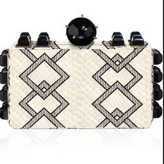 Geometric black and white clutch by @tonyahawkes