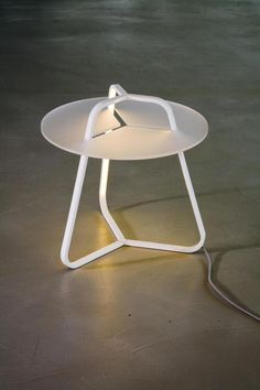 Table + Lamp in one!  'Table lamp' redefined by Martinelli Luce- Indirect and diffused LED light inside the three arms.