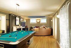 Game area and movie/video game area. No fireplace, but some built in cabinets. And a half bath somewhere. Games Room Inspiration, Room Ideas, Man Cave Basement, Interior Design Magazine, Built In Cabinets, Room Interior, My Dream Home, Game Room, Luxury Homes