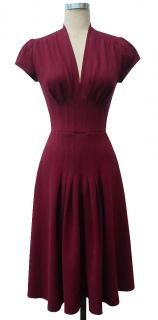 Jenny dress from Trashy Diva.  Cute, and might be flattering on my slightly-larger body.  :)