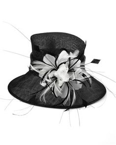 c07dadfc6773ec A tall crown and a feathery bouquet form a sophisticated straw hat.