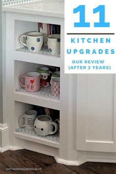 Need budget-friendly kitchen update tips, or honest advice on a kitchen makeover? Try 11 Kitchen Upgrades: Our Review (After 2 Years) by thetarnishedjewelblog.com. #kitchenupcycle #kitchenupdate #kitchenupgrade #kitchenremodel #kitchendesign #kitchensofinstagram #kitchenislanddesign #kitchenmakeovers #kitchencountertops #coastalkitchen #coastalfarmhouse #whitekitchens #whitekitchencabinets #whitekitchendesign #whitekitchen Upper Cabinets, White Kitchen Cabinets, Kitchen Countertops, Updated Kitchen, New Kitchen, Kitchen Layout, Kitchen Design, Microwave Drawer, Low Cabinet