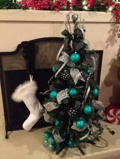 Turquoise Christmas tree  Would be awesome on a larger scale. Maybe even on a black tree!