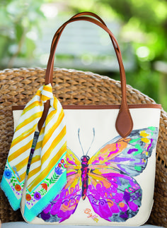"""A watercolored butterfly by designer Catherine Hong, embellished with pops of colorful embroidery, captures the very essence of spring. On its back, it reads, """"I want to fly like a butterfly around this beautiful world."""" Enjoy its removable fringed scarf on this tote or your outfit."""