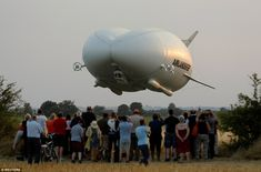 The Airlander 10 (pictured) - part plane, part helicopter, part airship - loomed overhead at Cardington airfield in Bedfordshire as the sun started to set on this evening. National Geographic, Lago Baikal, Aviation Industry, 10 Picture, World's Biggest, Zeppelin, Military Aircraft, Worlds Largest, England