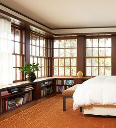 I love the feel of this room.  The big windows and bookshelves mainly.