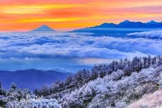 """Morning glow and Mt. Fuji by AOUEI from http://500px.com/photo/198253565 - This place can see Mt. Fuji in the distance. It is famous as a place to shoot Mt. Fuji. It is a very popular place to shoot landscape photographs in Japan. In the morning clouds spring above the lake of Suwa. この場所は高ボッチ富士山を遠くに眺めることができます富士山の撮影場所として有名です日本の風景写真の撮影地としてとても人気のある場所です秋から初冬にかけての朝はしばしば諏訪湖の上空に雲が湧きあがります  """"The  Most Beautiful and Breathtaking Places in Japan. """" A stunning view of Japan. """"Japan's most beautiful…"""