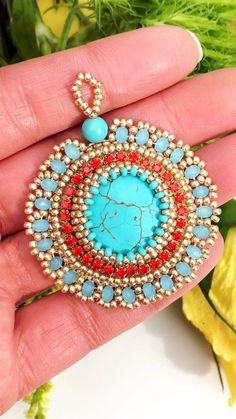 Beaded pendant, Bead Embroidery, Swarovski Crystals necklace, Beadwork This bead embroidered pendant with Swarovski Crystals, natural turquoise and red rhinestones is available at SplendidBeads's Etsy Shop Beaded Brooch, Beaded Earrings, Beaded Bracelets, Necklaces, Bead Embroidery Jewelry, Beaded Embroidery, Seed Bead Jewelry, Beaded Jewelry, Swarovski Crystal Necklace