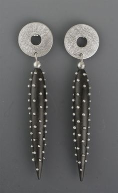 Earring   Suzanne Linquist (Red Circle Metals). Silver studded ebony, silver tops
