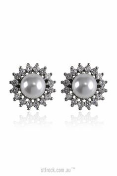 Samantha Wills Distance of Dawn Pearl Studs Earrings $69.90  Simple and elegant, the Distance of Dawn Pearls Stud Earrings feature a pearl surrounded by shimmering crystals. The most perfect way to complete your bridal look.