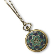 This brand new necklace style fashion watch has a 31 inch chain and it features a vintage look green and navy colored floral design decorative cover that opens to reveal a white face Geneva watch measuring approximately 46 millimeters. Perfect with nearly any attire, this unique fashion necklace ...