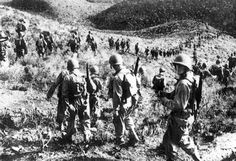 The 1st Ranger Battalion marching over hilly Algerian terrain in late January 1943, shortly before the raid against an Italian outpost at Sened Station in southern Tunisia.